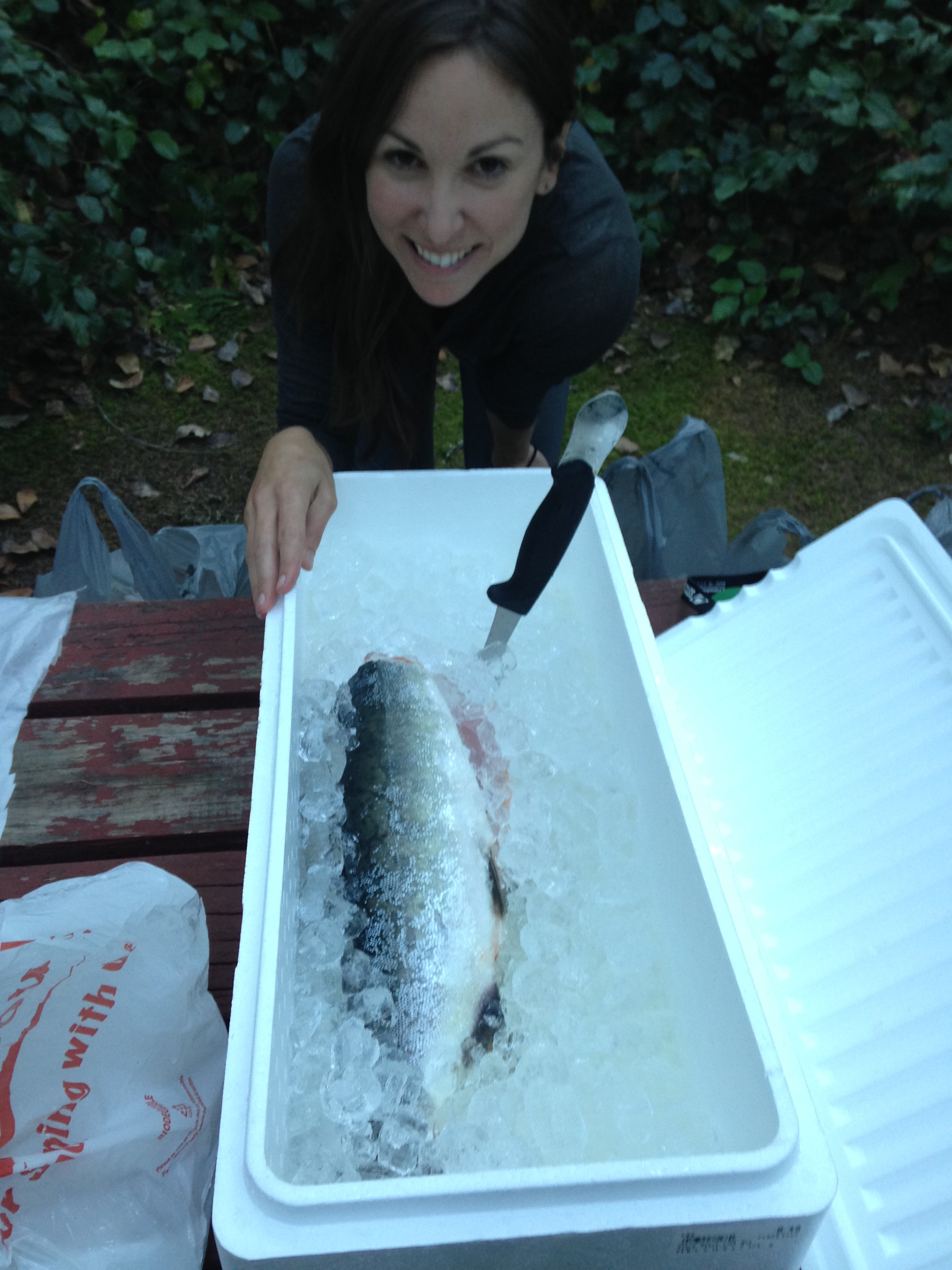 Fresh salmon, back at the camp site.  Jenine thinking up a good recipe